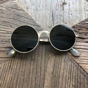 Le Specs round frame sunglasses.